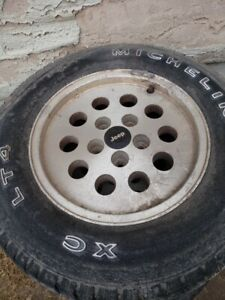 Jeep Cherokee rims and tires.