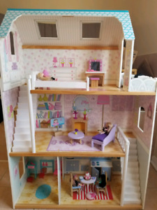 All wood dollhouse with furniture and dolls and dolls
