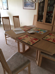 Solid oak dining room set, table six chairs, large hutch.