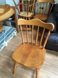 solid oak 4x chairs and a round table