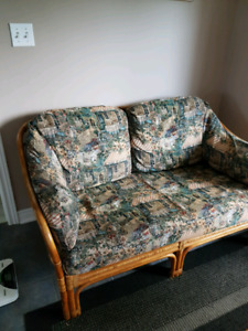 Wicker love seat and 2 swivel chairs.