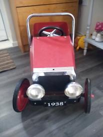 Vintage children peddle car