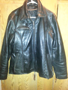 Ladies black leather jacket and black leather chaps motorcycle