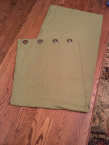 Two sets of green tweed curtains and matching green lamp