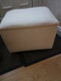 Cream coloured storage box, on wheels.