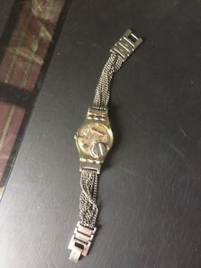 Swatch new battery and this is a rare one 60$ London Ontario image 3