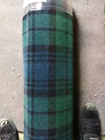 Blue and green tartan carpet remnant