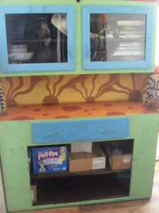 As is decorated Unusual Shelf/Buffet Cabinet.