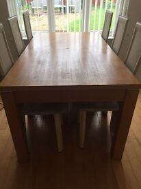 Large rectangular extendable dining table with 6 high back cream chairs