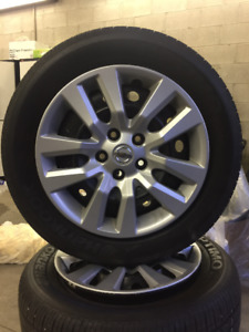 All season tires on steel rims/Hubcaps for 2015 Nissan Altima
