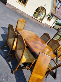 48. Tiger oak table and 6 chairs with 2 matching leafs