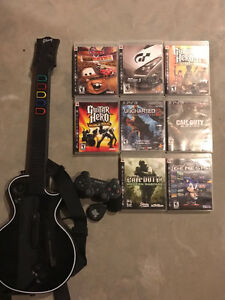 PS3 console w/controller and 8 games