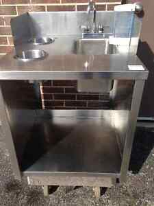 Stainless steel table with sink and 2 waste shute.Size 27'x 30,5