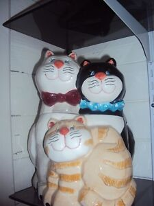 Cat family cookie jar from Bowrings mother, father and kitten.