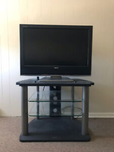 30 inch Toshiba T.V. and Stand with shelves