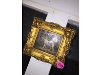Vintage dog paintings in ornate frames