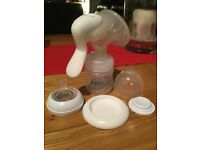 Avent Manual Breast Pump and Medela milk storage bottles and bags