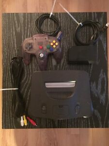 Nintendo 64 w/ expansion pack and 1 Atomic Purple Controllers