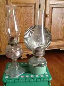 Two oil hurricane lamps