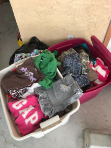 Two Bins of Girls ages 6-7 clothing