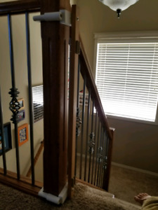 Baby gate banister attachment