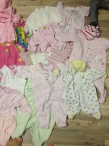 Bag of baby girls clothing, ranging from 3 - 12 months.
