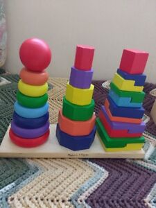 Educational toys lot .Wooden puzzles in a box and a stacking toy