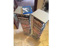 "2 DVD Stands (Over 37"" Tall) + 80 DVDs - See All Photos"