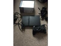 PlayStation 2 slim with 9 games