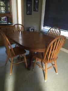 Kitchen table and 5 chairs and a cabinet to match
