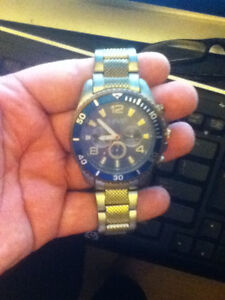 Gold and stainless steel August Steiner with blue dial.