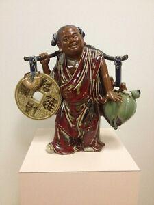 A vendre : Chinese Figurine Statue .