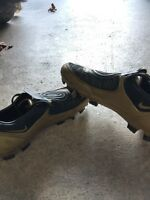 Gold Nike 90 soccer shoes