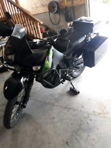 Almost new with warenty adventure bike