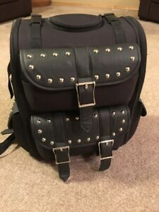 Black, studded, sissy bar luggage.