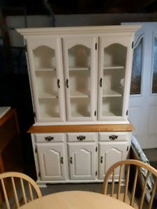 Solid wood table with 4 chairs and wall unit included.