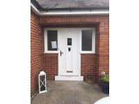 Free front Door with side window, wood. Has lock and letter box.
