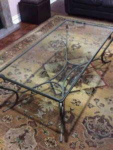 Glass coffee table with wrought rot iron legs