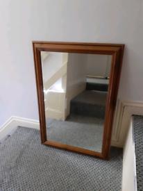 Antique Victorian pine mirror.
