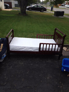 Cherrywood toddler bed with mattress - sold pending pick-up