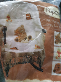 Popcorn bear throw cross stitch kit opened but never used.