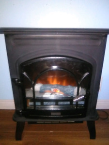 Stonegate Electric Fireplace Heater with flame and log effect.