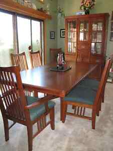 Solid dark wooden dining room set with matching china cabinet
