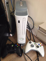 Xbox 360 with a controller and 7 games