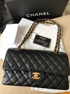 Chanel classic flap M/L black caviar with gold hardware