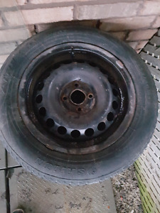 Set of used tires with rims