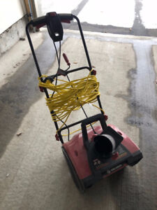 Electric snow thrower with extension cord
