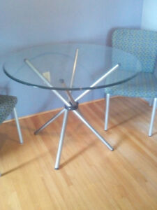 Mid-century glass top dining table perfect for condo