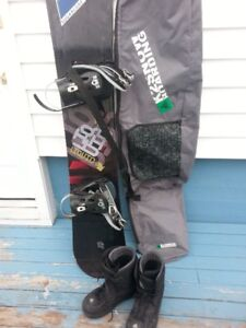 Liquid Snowboard with bindings, bag and boots size 10.
