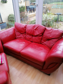 Red leather sofas and chair.